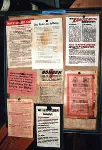 German-language leaflets dropped by American planes in the last days of the war, including a safe conduct pass (lower right corner).