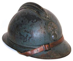 "A typical example of the French Model 1915 ""Adrian"" steel helmet, with early horizon blue paint and flaming bomb badge used for infantry units."