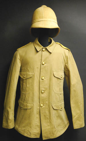 An American M1895 pattern tunic, one of several used during the Spanish-American War. Yellow shoulder boards denote cavalry.