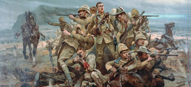 Khaki-clad British troops in the 17th Lancers return withering Boer fire at the Battle of Spion Kop in this period painting by Caton  Woodville.