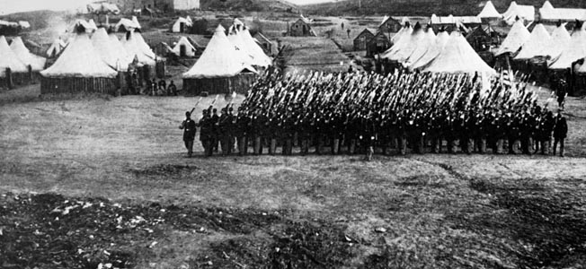 The 34th Massachusetts Infantry, photographed in camp near Washington, D.C., found itself in the thick of the fighting at New Market before driving from the battlefield.