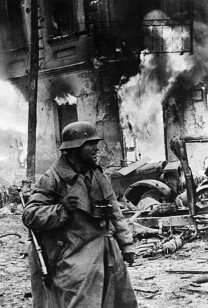 A battle-hardened German panzergrenadier makes his way through the town of Zhytomyr, Ukraine, in December 1943. Around Nikopol, the Wehrmacht and the Red Army fought for control of some of the richest mines in the world.