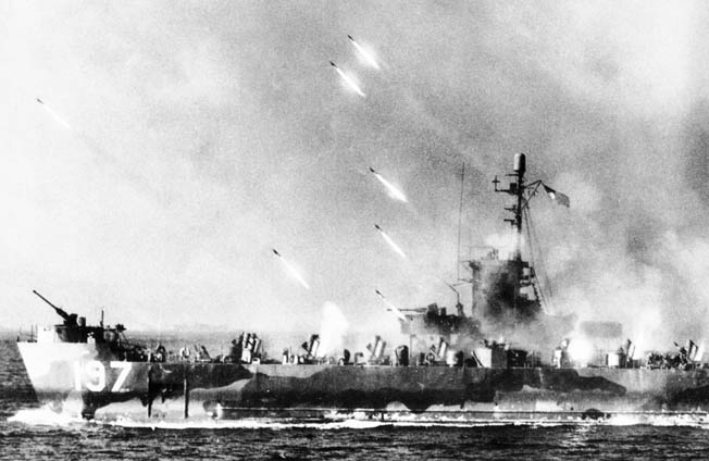 American warships support the amphibious landings by saturating Japanese positions with rockets and naval shells. Here a rocket gunboat unleashes a fusillade of explosives at the enemy.