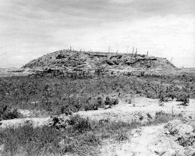 "The battered terrain feature known as ""Sugar Loaf Hill,"" where author and Marine veteran William Manchester said the life expectancy was ""about seven seconds."""