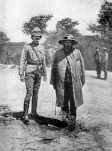 Boer General Piet Cronje stands with Lord Roberts' ADC after surrendering at Paardeberg.