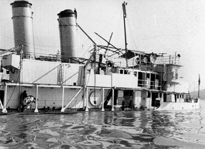 The Panay is shown partially submerged after the attack 28 miles from Nanking. Three crewmen were killed and 45 wounded.