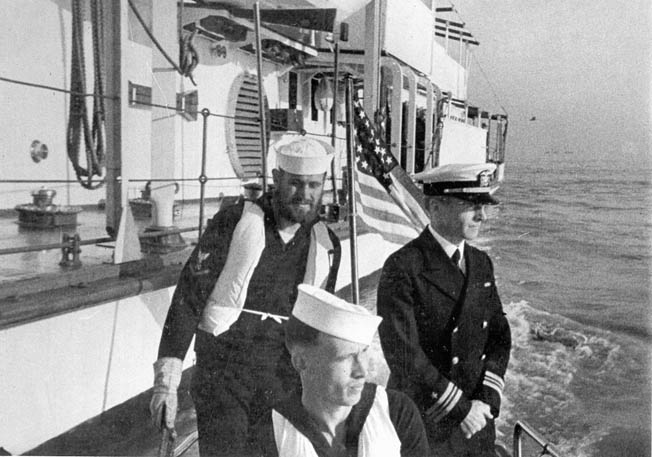 Lieutenant Commander James J. Hughes, right, captain of the gunboat Panay, is shown in a still frame from a film that was made on the day of the attack against the gunboat.