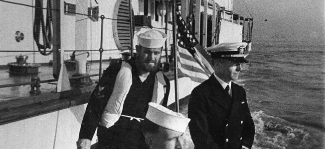 In a frame from a film made on the day of the attack, Lt. Cmdr. James J. Hughes (right), is shown in a launch near the Panay.