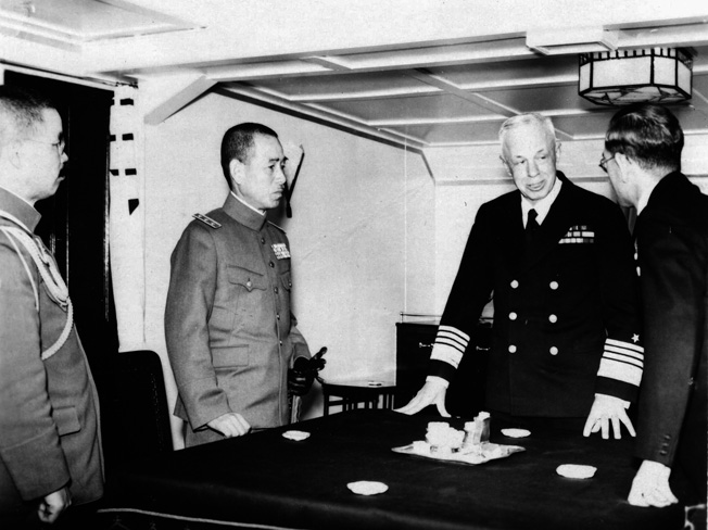General Shunroku Hata, left, commander of Japanese forces in China, visits with the Rear Admiral Henry E. Yarnell, commander of the U.S. Asiatic Fleet aboard an American vessel.