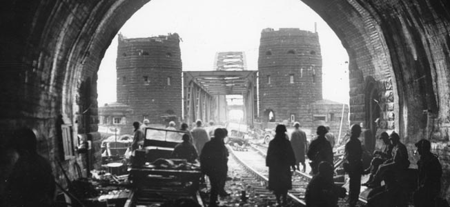 After crossing the Rhine via the Ludendorff Railroad Bridge at Remagen, American soldiers inspect the tunnel where German soldiers and civilians took refuge as fighting in the vicinity escalated. The tunnel extended beneath the Erpeler Ley, high ground on the eastern bank of the Rhine.