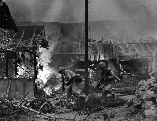 Emveloped in smoke and flame, Marines enter the town of Garapan on July 1, 1944.