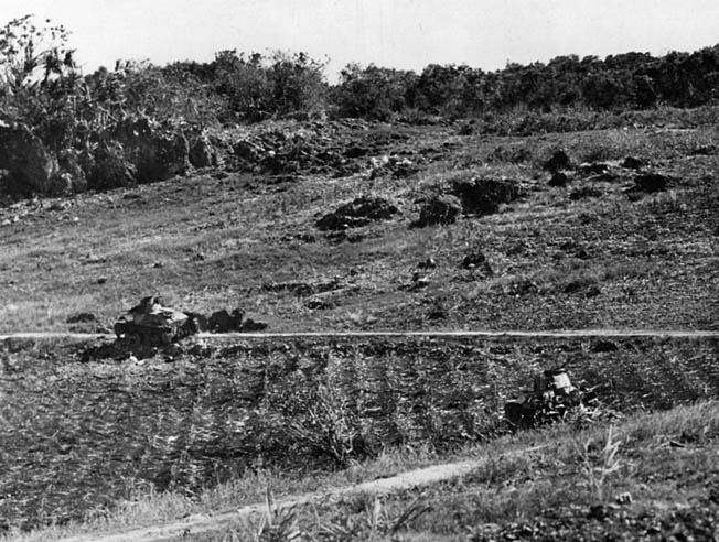 Burned-out Japanese tanks on the slopes of Mount Tapotchau are all that remain of the battle of June 16-17.