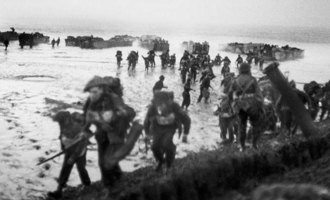 British soldiers of the 4th Special Service Brigade join in the assault on the Scheldt Estuary as they wade ashore to attack the town of Flushing on Walcheren Island, which commanded the approaches to the River Scheldt.