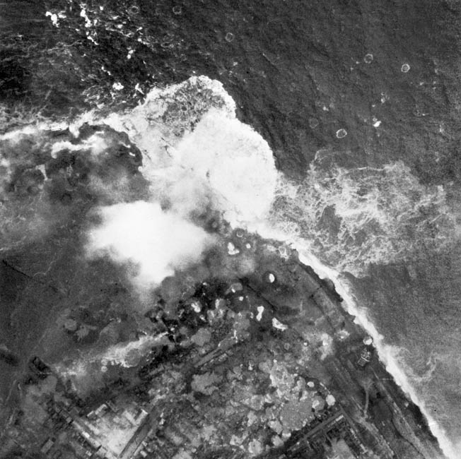 At the height of the battle for the Scheldt Estuary, bombs detonate on and around the Weskapelle Dike during a British Royal Air Force bombing raid on October 3, 1944.
