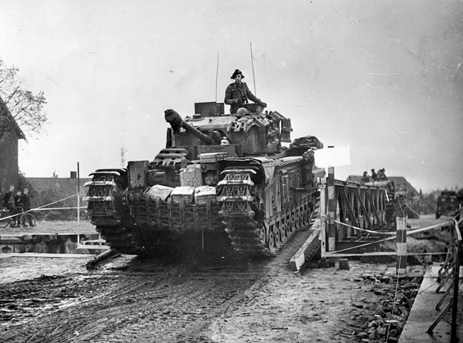 Churchill tanks cross a Bailey bridge over the Antwerp-Turnhout Canal at Ryckevorsel during the attack north of Antwerp, October 22, 1944.