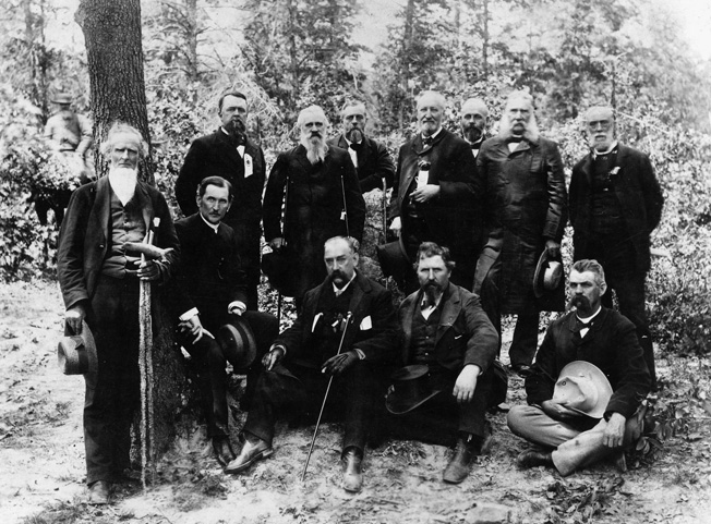 Old Confederates (and one Federal) pose at Chancellorsville in 1884. General James Longstreet stands in the rear, second from the right. Fourth from the right is Union General William Rosecrans, Longstreet's West Point roommate.