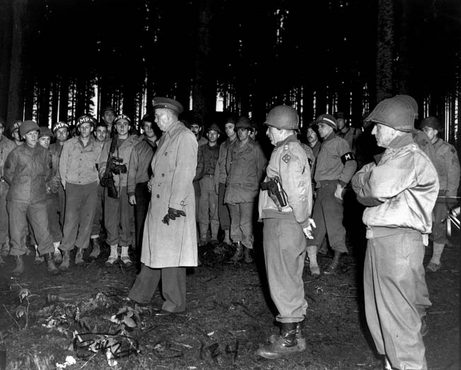 General George C. Marshall visits American soldiers in Europe in October 1944.  These troops are destined to fight the Nazis along the German frontier at the fortified Siegfried Line.