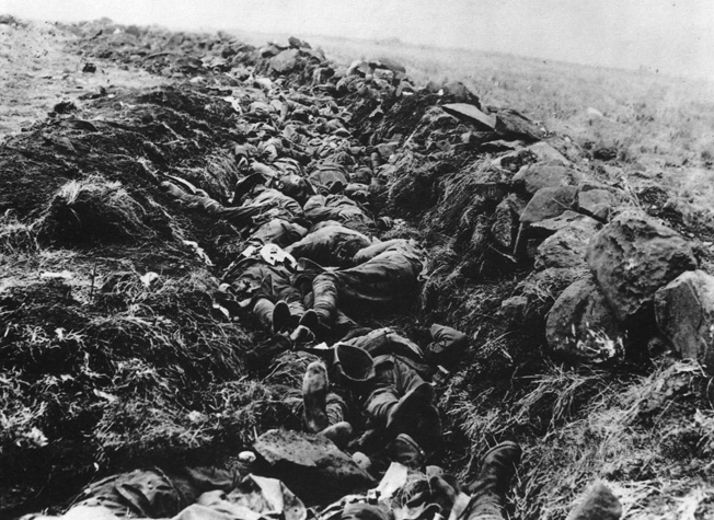 On the morning after the bloody fighting at Spion Kop, a large trench serves as a makeshift grave for some 400 dead soldiers who perished there.