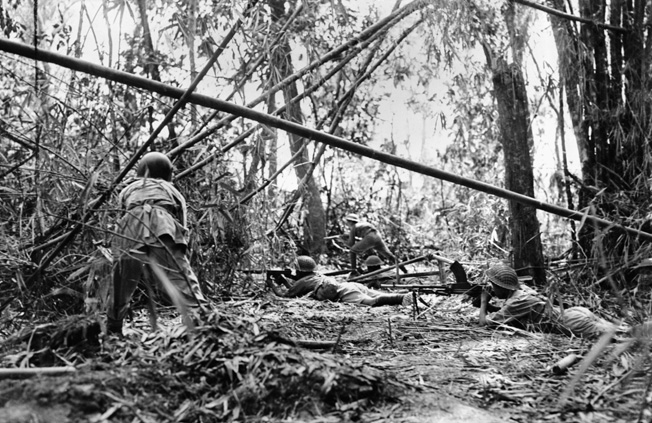 Well-armed Chinese troops advance through the heavy jungle ground cover toward Mytikyina.
