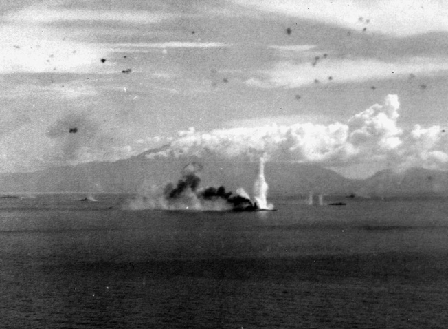 During the Leyte Gulf fight, the super battleship Musashi is relentlessly assaulted by U.S. planes in the Sibuyan Sea.