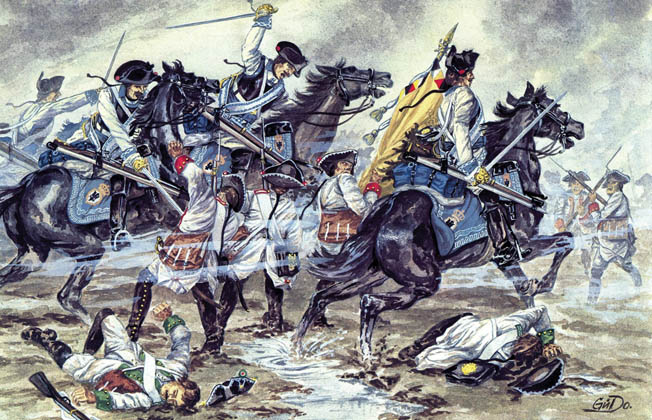 Prussian cuirassiers in white uniforms charge the Austrian right flank late in the day.