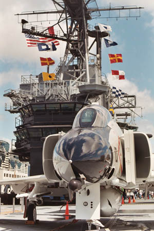 A jet sits at the ready on Midway's top deck.