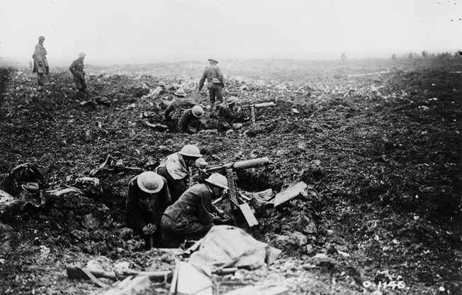 Canadian machine gunners dig themselves into convenient shell holes on Vimy Ridge in support of the infantry attack.