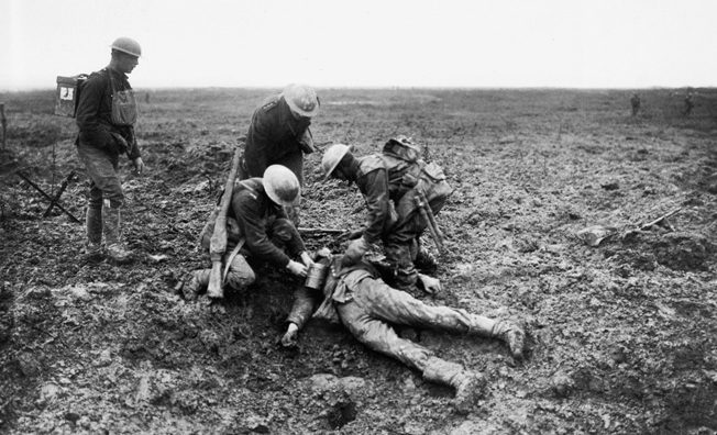 Canadian troops tend to a badly wounded German casualty at Vimy Ridge
