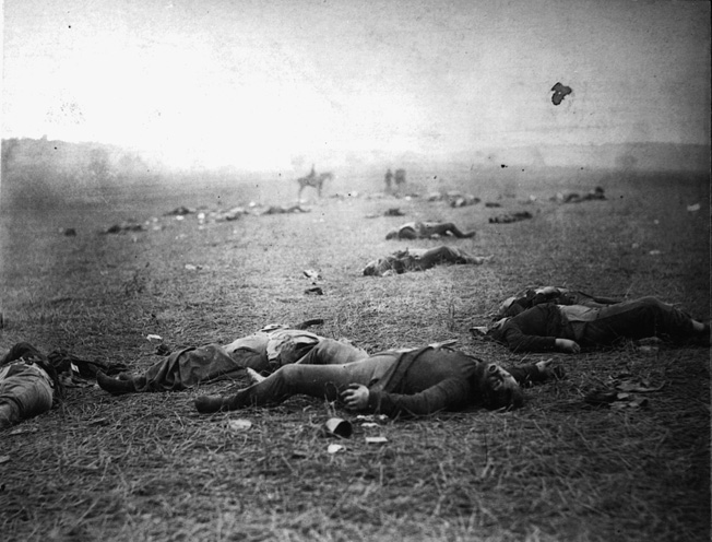 The bloated corpses of Federal soldiers litter a field at Gettysburg in Timothy O'Sullivan's aptly-titled photograph Harvest of Death.