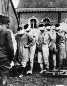 American victims of poison gas shuffle blindly through a french hospital courtyard during World War I.