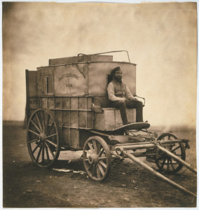 Roger Fenton, photographed with the wagon that carried his photographic equipment.