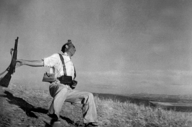 Spanish loyalist Frederico Borrell Garcia is captured at the moment of his death at Cerro Muriano by photographer Robert Capa on September 5, 1936. Capa's Falling Soldier remains the most controversial war photo in history.