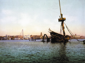 The USS Maine lies scuttled in Havana Harbor in William Henry Jackson's photograph.