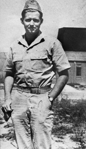 Lieutenant Joseph P. Kennedy, Jr., eldest son of the prominent Kennedy family, poses for a photo on the day of the mission during which he lost his life. This was the last image taken of the young officer.