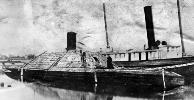 The salvaged Albemarle at Norfolk Navy Yard in 1865. The gunboat, which featured an octagonal casemate covered in two layers of armor plate, was armed with two Brooke rifled guns and an 18-foot bow ram.