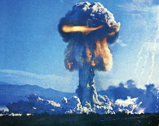 The now familiar mushroom cloud rises above the Frenchman's Flat test facility in Nevada during a 1960s test of the XW-51 minimum-size atomic warhead.