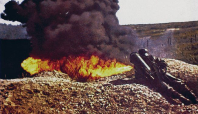 A German soldier in action during WWII with a flammenwerfer 35. A single triffer operated the pressurized nitrogen tank and ignited the oil fuel.
