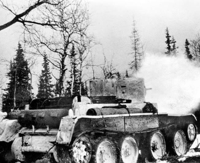 During one of several pitched battles in the brief Winter War, a Soviet tank fires on a distant Finnish target in this still from the newsreel documentary film Mannerheim Line.