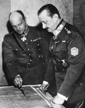 Baron Carl Gustav Mannerheim (left), supreme commander of Finnish Army forces, consults with General Axel Heinrichs, commander of the III Corps, during efforts to stem the tide of Red Army forces invading Finland.