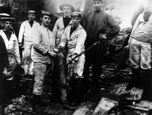 Men of the HMS Prince Eugene repair damages aboard vindictive shortly after her return from Zeebrugge.