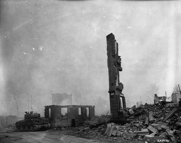 A U.S. tank, disabled during the fighting, sits among the rubble of Heilbronn.