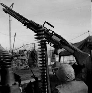 "The M60 machine gun was what the military called a ""crew-served weapon,"" requiring a team of three soldiers to transport, load, and fire it."