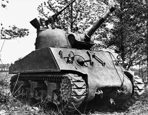 The 105mm-armed M4A3 Sherman tank, known as the M4A3 105 HVSS, was used for infantry and assault support. Miller found the 105mm shells heavy as he passed them to the gunner.