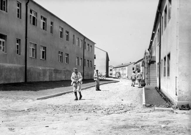 Prisoners on a camp street, 1943. The camp was cleaned up for official photographs such as this; in reality, most parts of the severely overcrowded prisoner enclosure were disgustingly filthy.