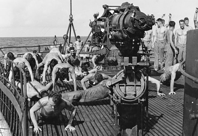 Staying in shape during their voyage to Makin, a group of Carlson's Raiders does calisthenics aboard the submarine USS Nautilus.