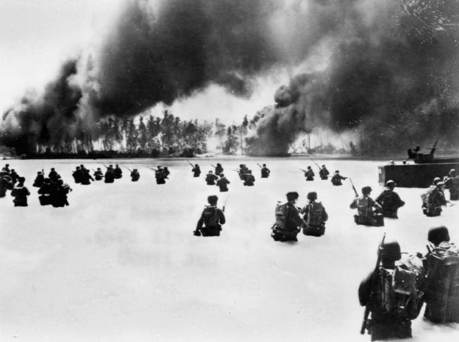 Soldiers of the U.S. Army's 2nd Battalion, 165th Infantry Regiment, 27th Infantry Division wade ashore on Makin Atoll in the Gilbert Islands in November 1943.