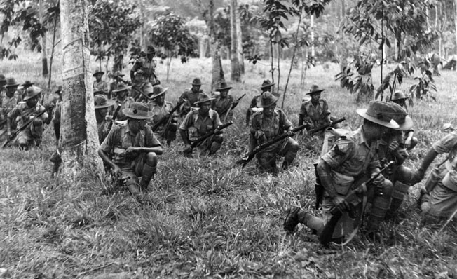The 9th Gurkhas train in the jungle of the Malay Peninsula prior to the coming of war. The Gurkhas fought bravely and sustained heavy casualties in the futile defense against the Japanese advance on Singapore.