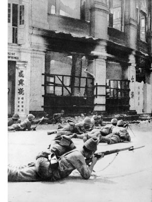 Japanese soldiers take up positions on January 11, 1942.