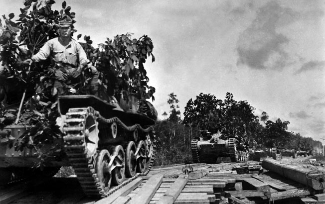 Japanese tanks advance across a bridge toward the town of Johor Bahru during their lightning conquest of the Malay Peninsula.