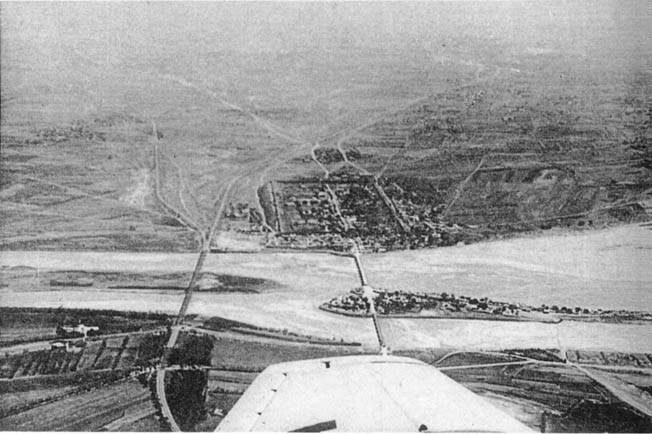 An aerial view of the Marco Polo Bridge, a stone structure spanning the Yongding River, displays the panoramic scene of the incident between Chinese and Japanese troops in early July 1937.